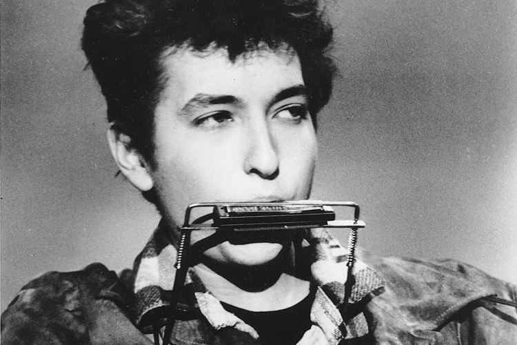 Folk singer and songwriter Bob Dylan plays the harmonica and acoustic guitar in March 1963 at an unknown location.  He was born in Duluth, Minnesota in 1941 as Robert Allen Zimmerman. (AP Photo)